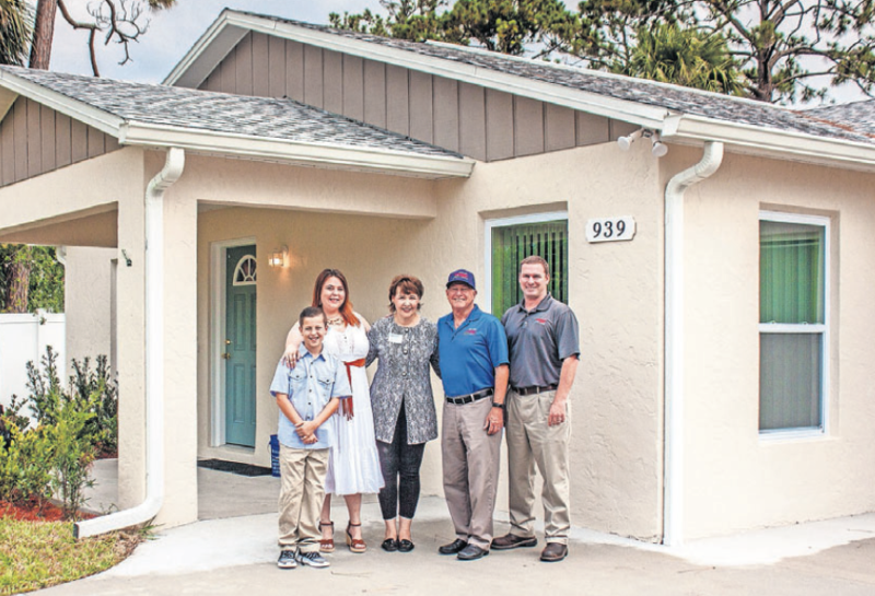 (l-r) Homeowners Andrew and Danielle; Lori Gillooly, CEO of Habitat for Humanity of Greater Volusia County; Bill Thompson, Chairman of Thompson Pump; and Chris Thompson, President of Thompson Pump.