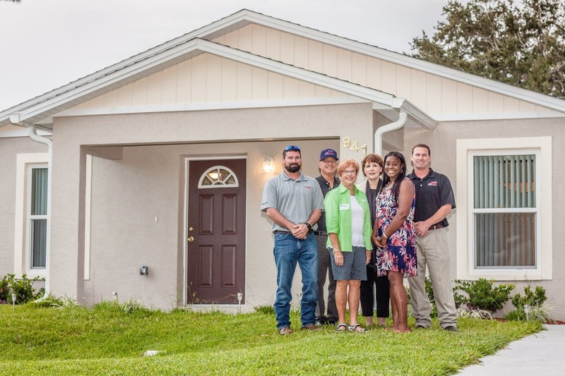 (l-r) Bobby Thompson, Regional Manager of Thompson Pump; Bill Thompson, Chairman of Thompson Pump; Patricia Ford, President of Habitat for Humanity of Greater Volusia County; Lori Gillooly, CEO of Habitat for Humanity of Greater Volusia County; Danyelle Adkins, homeowner; and Chris Thompson, President of Thompson Pump.